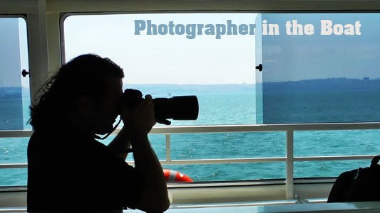 Thumbnail for Photographer In The Boat