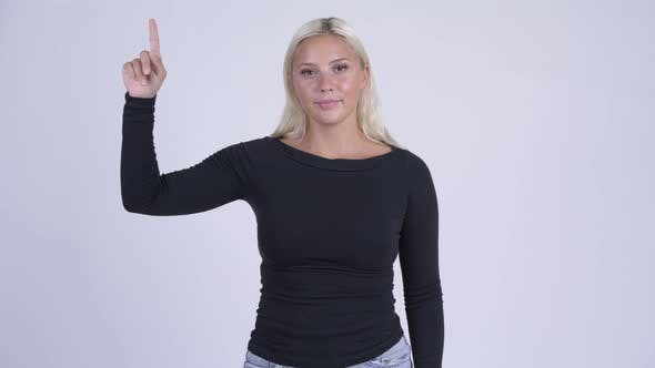 Cover Image for Young Beautiful Blonde Woman Pointing Up