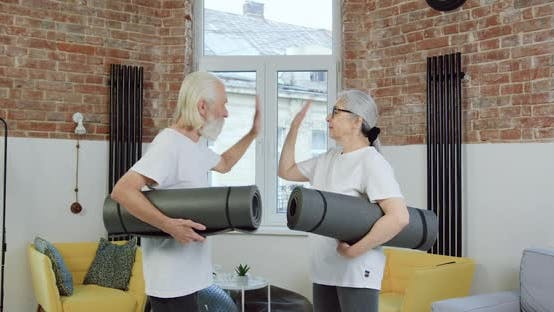 Thumbnail for Senior Couple in Sportswear Giving High Five Each other Before Start to do exercises