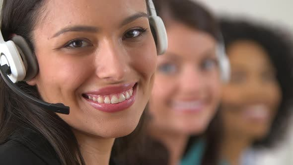 Thumbnail for Mexican customer service representative with two co workers in background