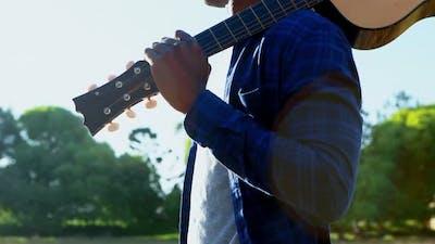 Man holding guitar at festival 4k