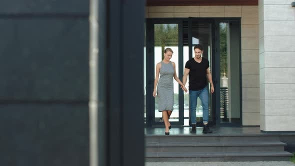 Thumbnail for Confident Couple Going Outside From Hi Tech Building Together