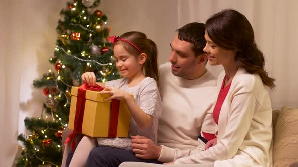Thumbnail for Happy Family with Christmas Present at Home