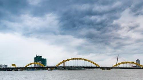 Time lapse: dramatic stormy sky over Dragon Bridge in Da Nang, Vietnam