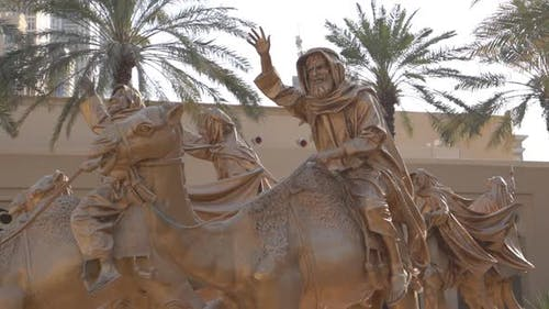 a Statue of a Bedouin on a Camel