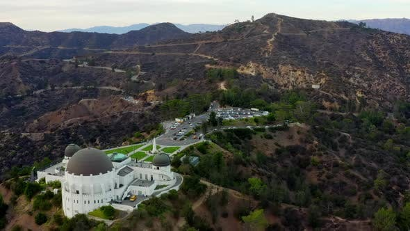 AERIAL Over Griffith Observatory with Hollywood Hills in Daylight Los Angeles California Cloudy