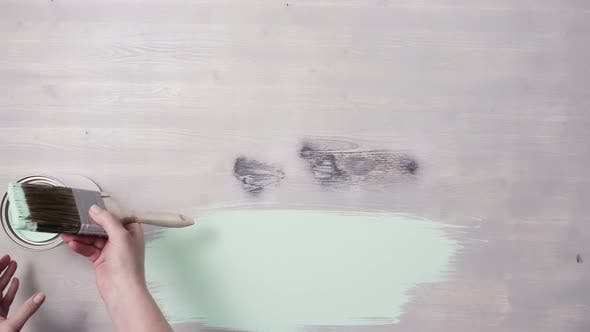 Thumbnail for Home improvement project. Painting wood with turquoise color paint.