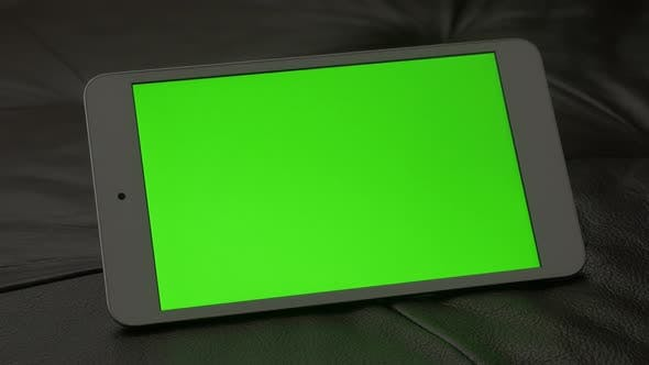 Thumbnail for Green screen presented on  PC tablet computer 4K 2160p UltraHD footage - PC silver tablet on leather