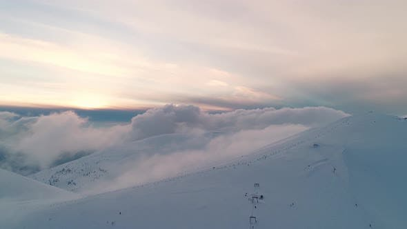 Winterland Fly Over Mountains in Evening Sunlight