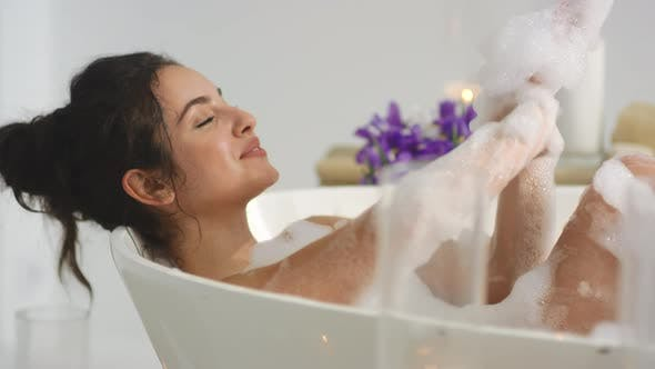 Thumbnail for Closeup Relaxed Woman Washing Hands in Foam Bath. Hot Girl Resting in Bathtub.