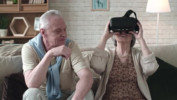 Cover Image for Elderly Woman Trying Virtual Reality Glasses