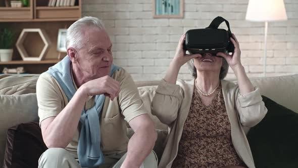 Elderly Woman Trying Virtual Reality Glasses