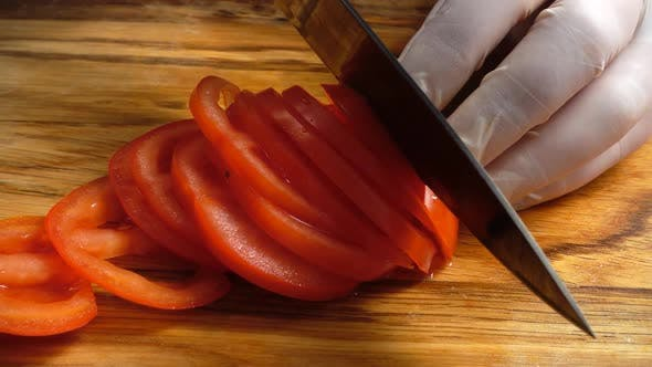 Thumbnail for The Cook Cuts Tomatoes 5