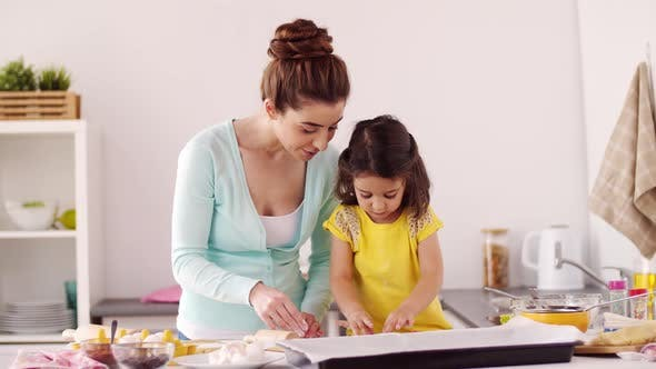 Thumbnail for Happy Mother and Daughter Making Cookies at Home 21