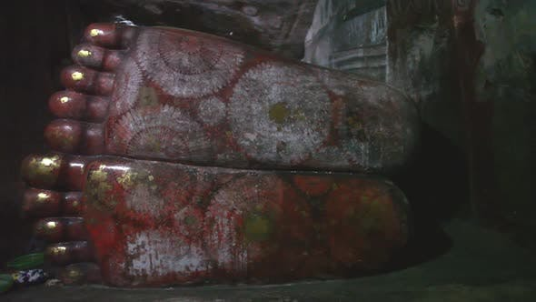 Thumbnail for DAMBULLA, SRI LANKA - FEBRUARY 2014: The view of a sleeping Buddha's feet at the Golden Temple of Da