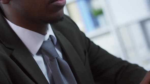 Thumbnail for Man in Headphones Communicating Online