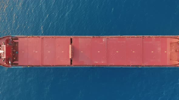 Freight Ship Floating on Sea. Aerial View