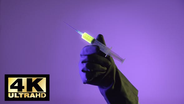 Thumbnail for Syringe With A Glowing Liquid