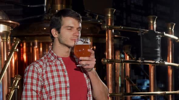 Thumbnail for Professional Brewer Smelling Delicious Freshly Brewed Craft Beer
