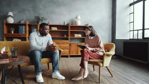 Afro-American Man Speaking with Female Counseling Psychologist