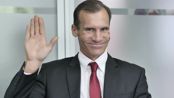 Thumbnail for Hello, Businessman Waving Hand to Welcome