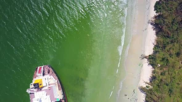 Thumbnail for Vertical Aerial View Sea Washes Tanker Grounded on Beach