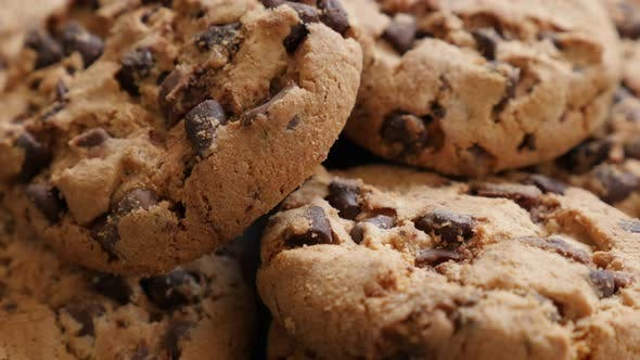 Thumbnail for Lot of chip cake cookies with chocolate close-up tilting 4K 3840X2160 30fps UHD footage - Slow tilti