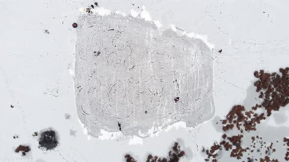 Thumbnail for Ice skating in circles on cold freezing ice lake