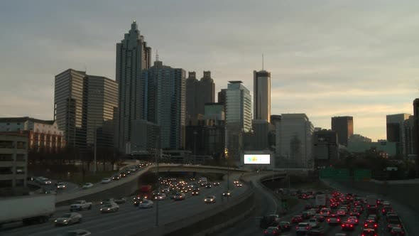 Static, extremely sped up shot of traffic on the freeway in Atlanta, Georgia.