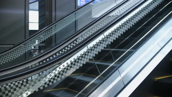Cover Image for Escalator in airport, train station, subway underground or modern business center