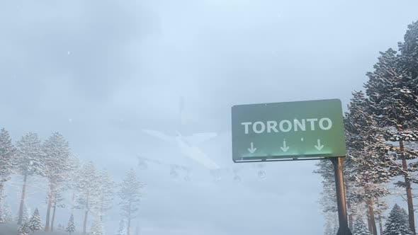 Cover Image for Airplane Arrives to Toronto In Snowy Winter