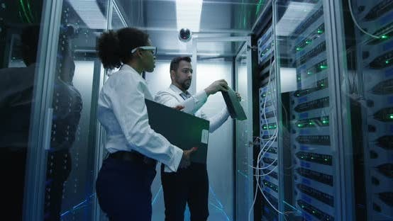 Thumbnail for Two Employees Performing Maintenance in a Data Center