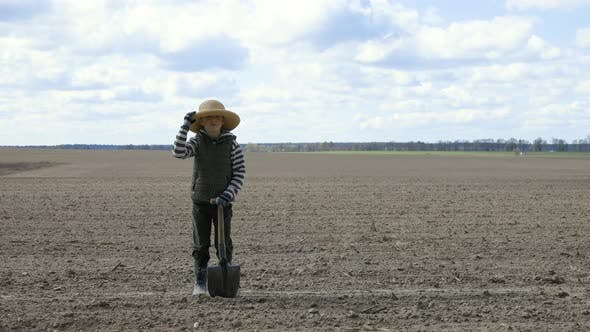 Thumbnail for The Farmer Boy in the Field Holds a Hat