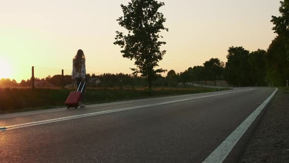 Thumbnail for Cheerful Lady with Suitcase Walking on Road.