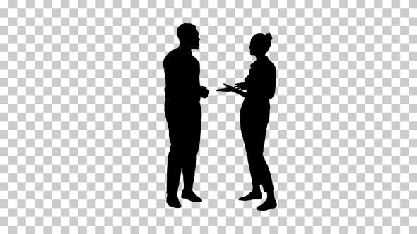 Silhouette Afro american guy and girl talking about business
