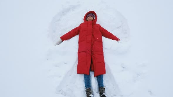 Thumbnail for Happy Woman Doing a Snow Angel, Top View