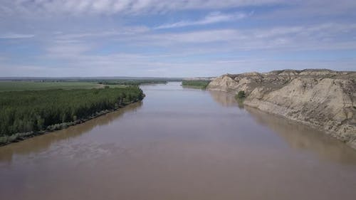 Aerial Drone of Yellowstone River in Summer Cleared Riparian Forest