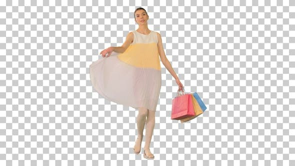 Young girl walking in summer dress holding, Alpha Channel