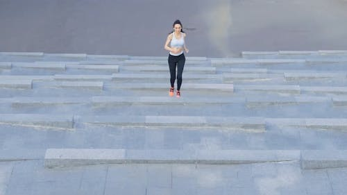 Female Jogger Running Up on Staircase