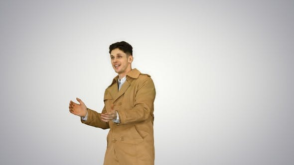 Cover Image for Young man wearing trench coat dancing and having fun on