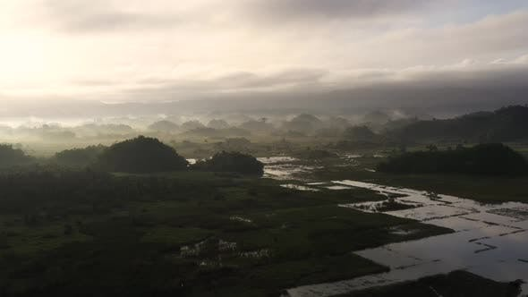 Thumbnail for Landscape with Farmland and Green Hills, Aerial View. Fog in the Early Morning