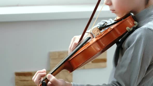 Thumbnail for Playing the Violin. Unrecognizable Seven Years Old Boy Playing the Violin