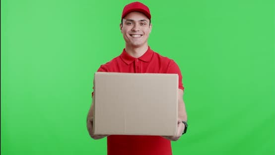 Thumbnail for Friendly Courier in Red Uniform Offering Big Parcel To Camera