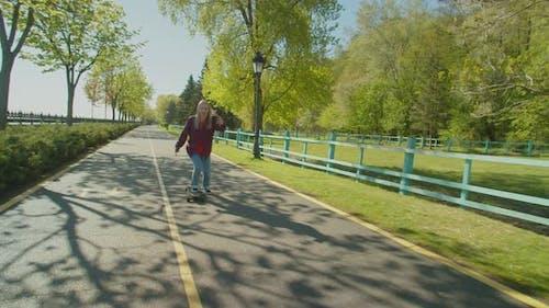 Hipster Woman on Skateboarding Live Streaming Vlog on Mobile Phone