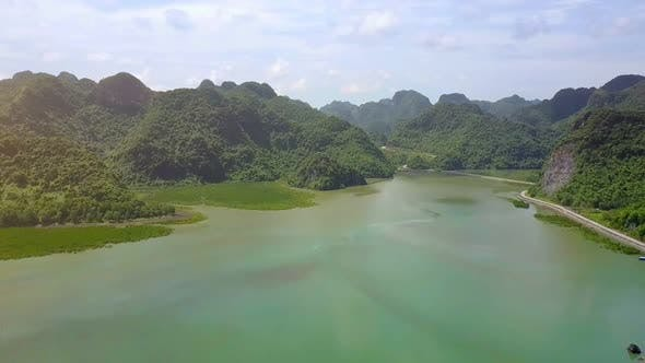 Thumbnail for Drone Shows Long Road Around Island Against Pictorial Sea Bay