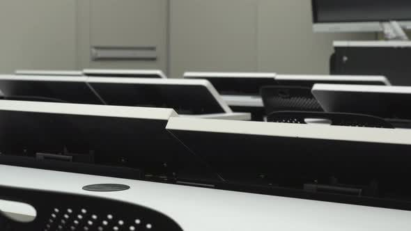 Close Up of Desks with Motorized Monitor Lift Screens