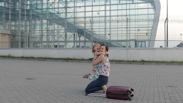 Thumbnail for Mother Meet Her Daughter Child Near Airport Terminal with Open Arms After Long Flight Trip Work