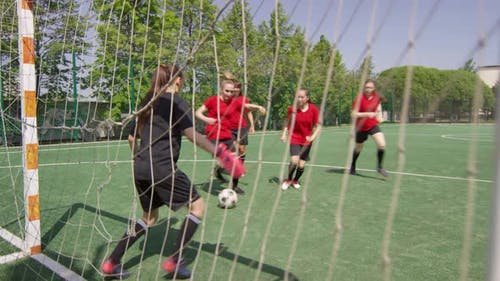Female Football Players Scoring Goal during Outdoor Match