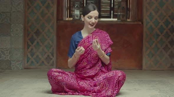 Thumbnail for Smiling Woman in Sari Applying Dry Perfume on Neck