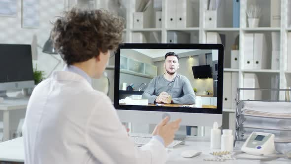 Thumbnail for Doctor Talking to Man by Video Call